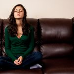 Young Lady On A Leather Couch